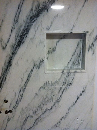 marble shelf in marble shower install